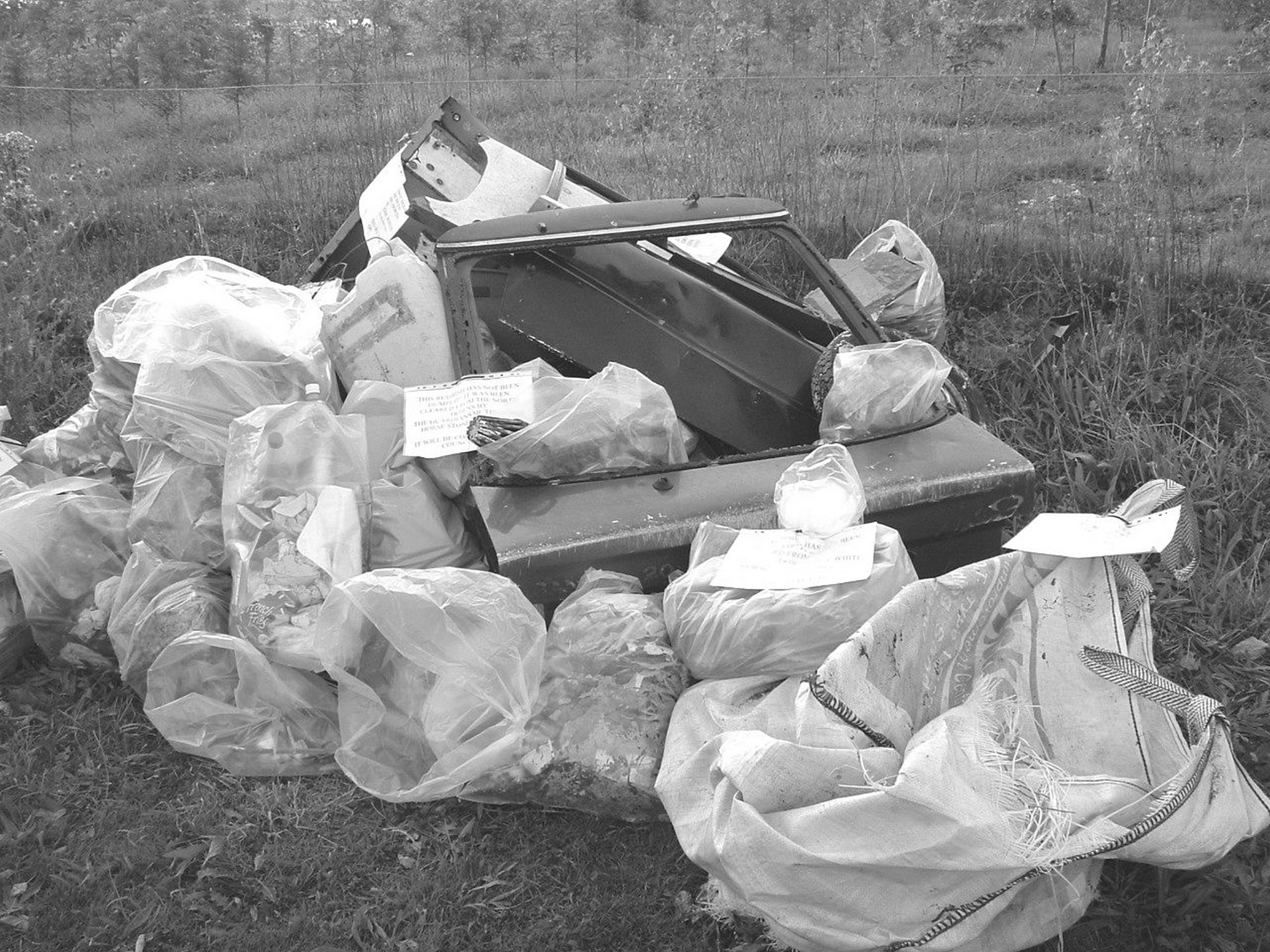 The collected rubbish labelled ready for removal.